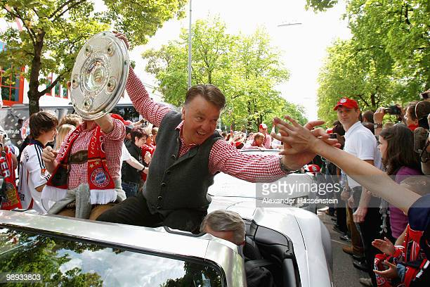 Louis van Gaal head coach of Bayern Muenchen and manager Christian Nerlinger celebrate the German championship with the trophy on the way to the...