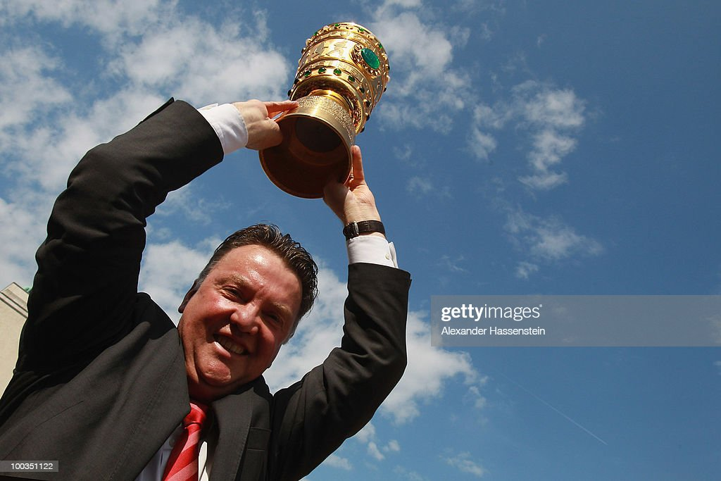 Louis van Gaal, head coach of Bayern Muenchen celebrate with the German Cup trophy on May 23, 2010 in Munich, Germany. The team returns from the UEFA Champions League final football match against Inter Milan at the Santiago Bernabeu stadium in Madrid on May 22, 2010.