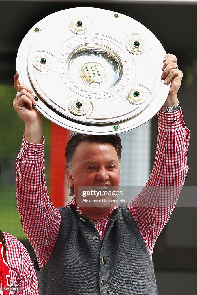 Louis van Gaal, head coach of Bayern Muenchen celebrates the German championship with the trophy on the way to the champions party at the Marien Place on May 9, 2010 in Munich, Germany.