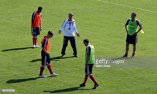 Louis van Gaal head coach of Bayern Muenchen gives instructions during the FC Bayern Muenchen training session at the Al Nasr training ground on...