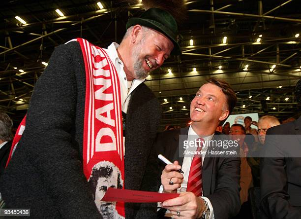 Louis van Gaal head coach of Bayern Muenchen talks to a supporter during the FC Bayern Muenchen general meeting at the Neue Messe Munich on November...