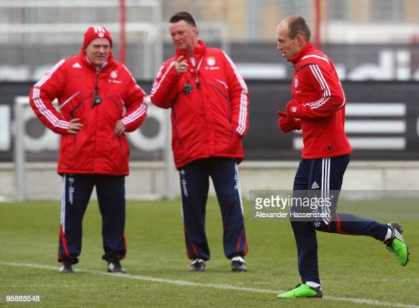Louis van Gaal head coach of Bayern Muenchen talks to his assistant coach Hermann Gerland whilst player Arjen Robben exercises during the Bayern...