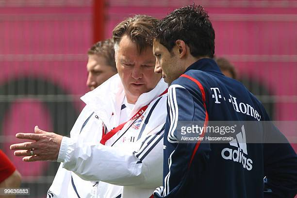 Louis van Gaal head coach of Bayern Muenchen talks to his player Mark van Bommel during the Bayern Muenchen training session at Bayern's training...