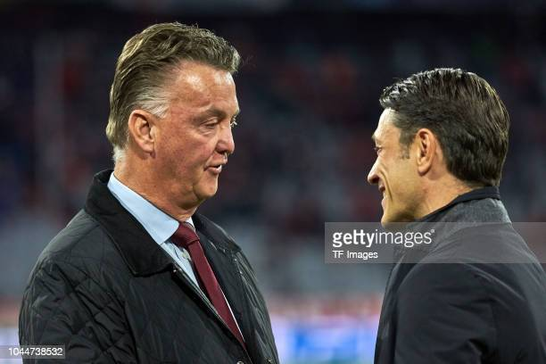Louis van Gaal im speak with Head coach Niko Kovac of Bayern Muenchen during the Group E match of the UEFA Champions League between FC Bayern...