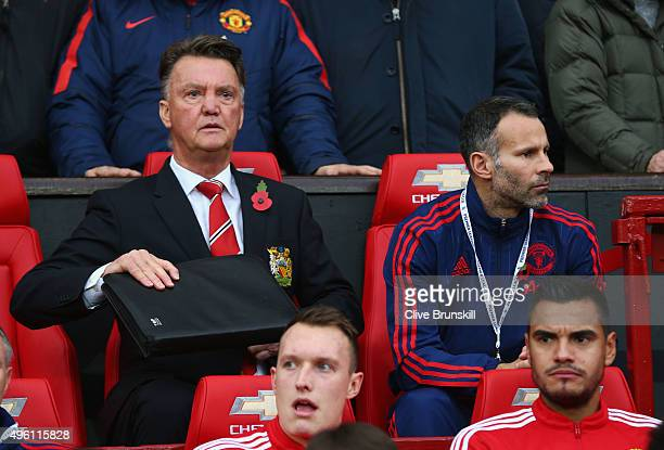 Louis van Gaal Manager and assistant manager Ryan Giggs of Manchester United are seen on the bench prior to the Barclays Premier League match between...
