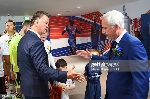 Louis van Gaal Manager of Manchester United and Alan Pardew shake hands in the tunnel prior to The Emirates FA Cup Final match between Manchester...