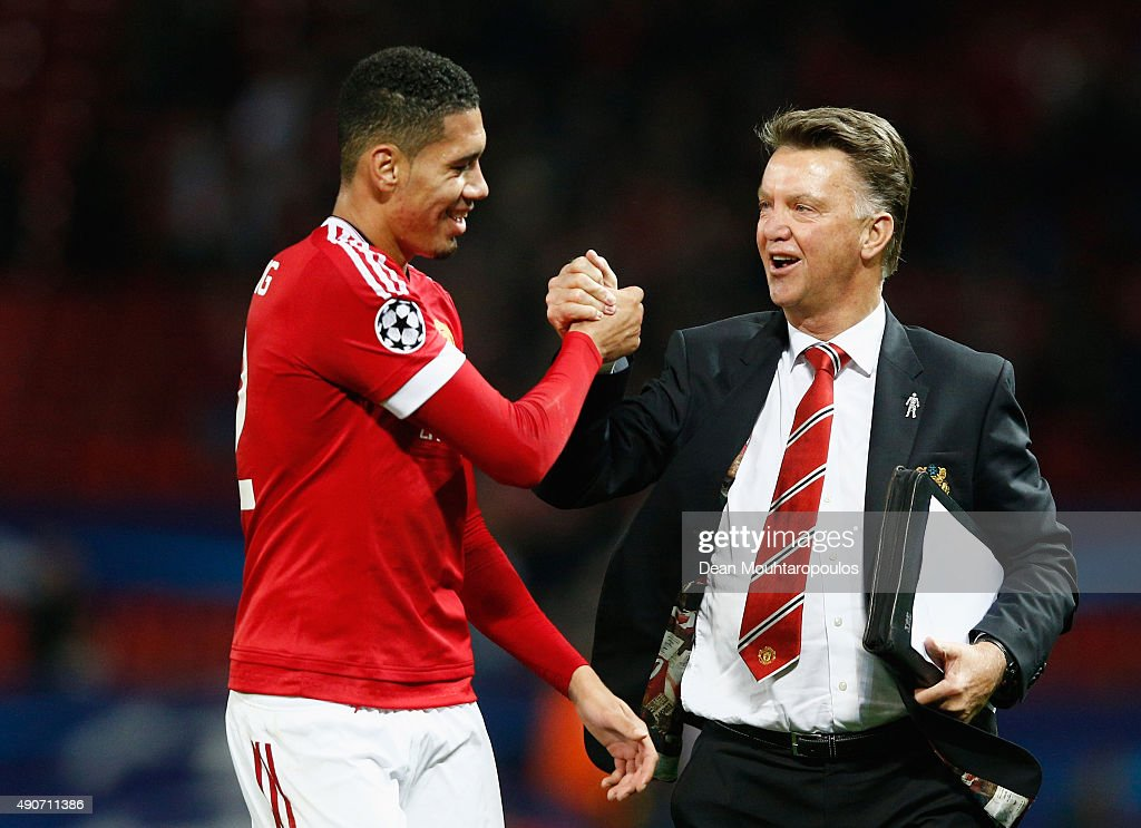 Louis van Gaal manager of Manchester United celebrates victory with winning goalscorer Chris Smalling in the UEFA Champions League Group B match between Manchester United FC and VfL Wolfsburg at Old Trafford on September 30, 2015 in Manchester, United Kingdom.