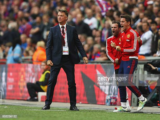 Louis van Gaal manager of Manchester United celebrates with Juan Mata and Ander Herrera as Jesse Lingard of Manchester United scores their second...