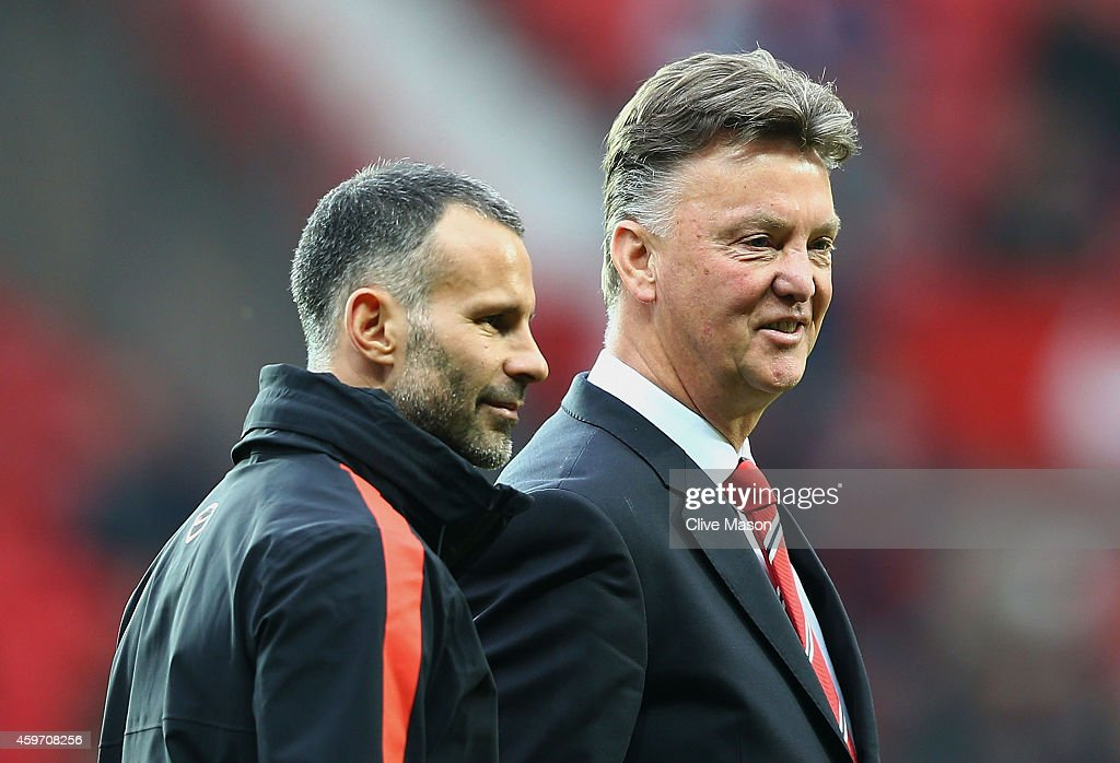 Louis van Gaal manager of Manchester United in discussion with assistant Ryan Giggs prior to the Barclays Premier League match between Manchester United and Hull City at Old Trafford on November 29, 2014 in Manchester, England.
