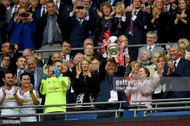 Louis van Gaal Manager of Manchester United lifts the trophy after winning The Emirates FA Cup Final match between Manchester United and Crystal...