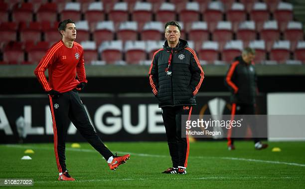 Louis van Gaal Manager of Manchester United looks on as Paddy McNair of Manchester United warms up during a training session ahead of the UEFA Europa...