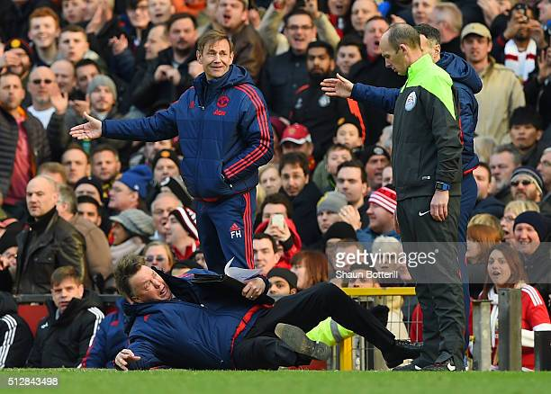 Louis van Gaal, Manager of Manchester United makes a point to the fourth official during the Barclays Premier League match between Manchester United...