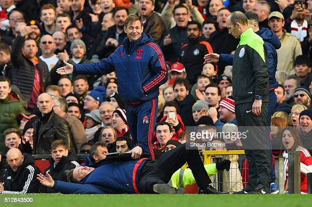 Louis van Gaal Manager of Manchester United makes a point to the fourth official during the Barclays Premier League match between Manchester United...