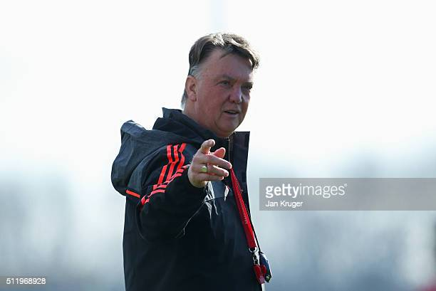 Louis van Gaal manager of Manchester United points during a Manchester United training session ahead of their UEFA Europa League round of 32 second...