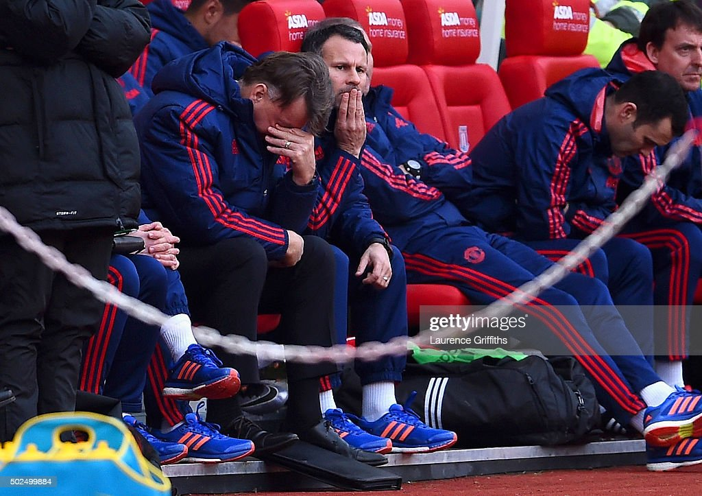 Louis van Gaal, manager of Manchester United reacts on the bench next to his assistant Ryan Giggs during the Barclays Premier League match between Stoke City and Manchester United at Britannia Stadium on December 26, 2015 in Stoke on Trent, England.