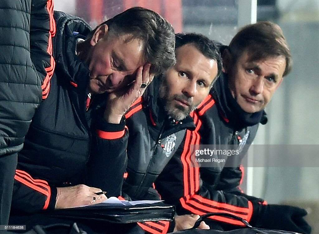 Louis van Gaal (L) Manager of Manchester United scratches his head while Ryan Giggs (C) assistant manager looks on during the UEFA Europa League round of 32 first leg match between FC Midtjylland and Manchester United at Herning MCH Multi Arena on February 18, 2016 in Herning, Denmark.