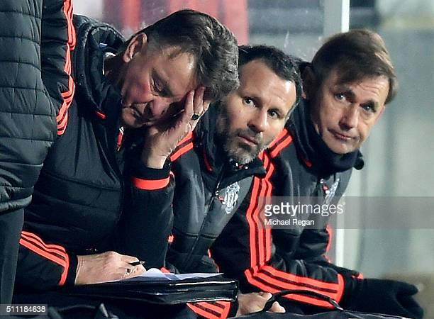 Louis van Gaal Manager of Manchester United scratches his head while Ryan Giggs assistant manager looks on during the UEFA Europa League round of 32...