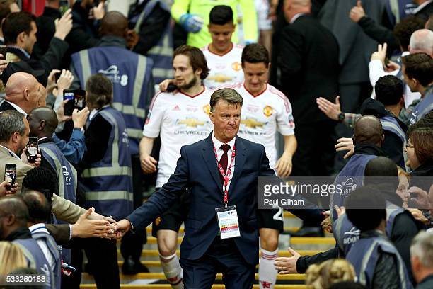 Louis van Gaal Manager of Manchester United shakes hands with fans after winning The Emirates FA Cup Final match between Manchester United and...