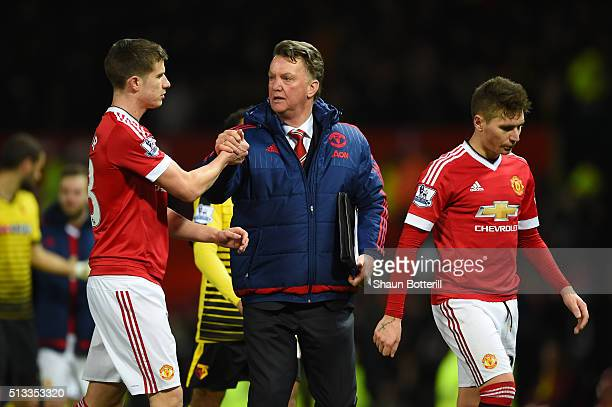 Louis van Gaal Manager of Manchester United shakes hands with Paddy McNair after the Barclays Premier League match between Manchester United and...