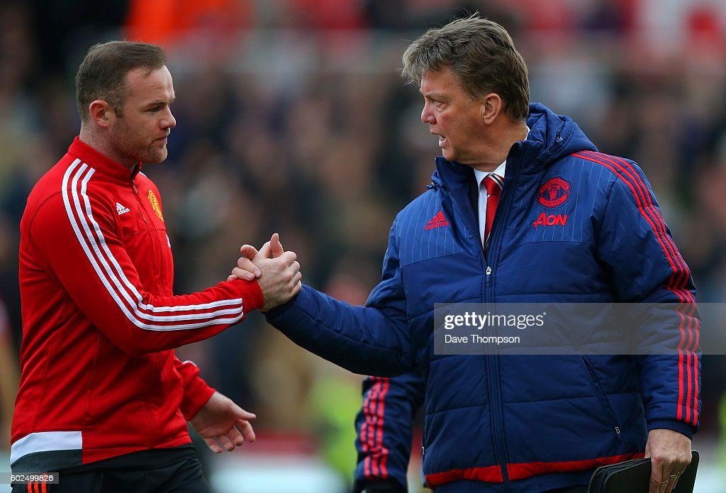 Louis van Gaal, manager of Manchester United shakes hands with Wayne Rooney of Manchester United during the Barclays Premier League match between Stoke City and Manchester United at Britannia Stadium on December 26, 2015 in Stoke on Trent, England.