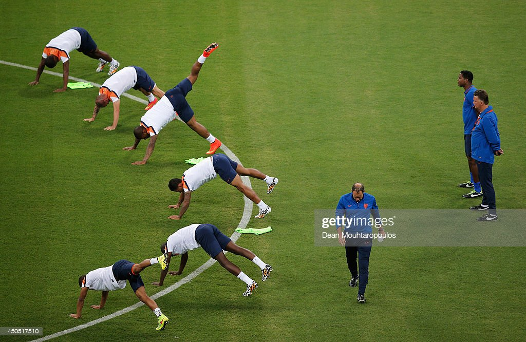 Louis van Gaal, Netherlands national football team manager and Patrick Kluivert watch the players warm up during the Netherlands training session ahead of the 2014 FIFA World Cup Group B match between Spain and the Netherlands held at the Arena Fonte Nova on June 12, 2014 in Salvador, Brazil.