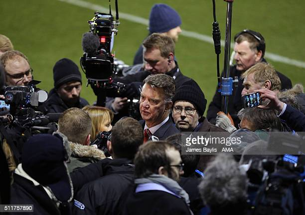 Louis van Gaal the head coach / manager of Manchester United is surrounded by local and national media for his post match press conference after the...