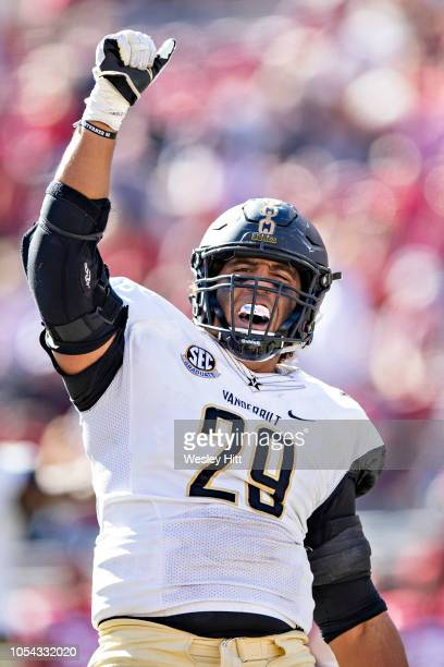 Louis Vecchio of the Vanderbilt Commodores celebrates after recovering a fumble in the second half of a game against the Arkansas Razorbacks at...