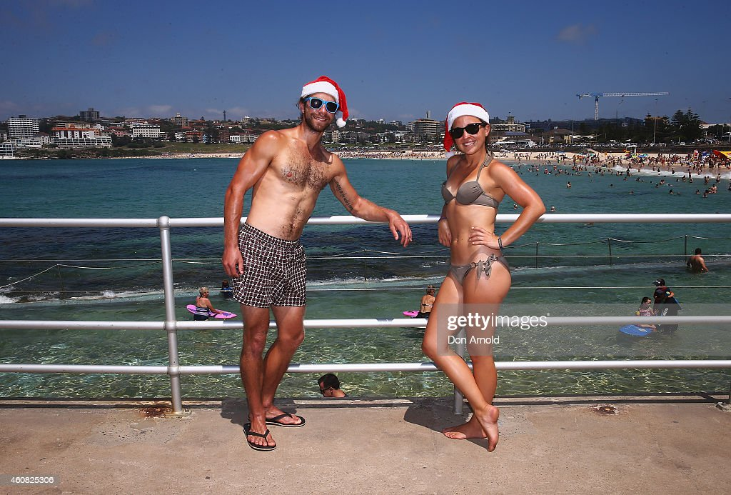 Louis Vitsko and Britney Morello from Ohio, USA pose at Bondi Beach on December 25, 2014 in Sydney, Australia. Bondi Beach is a popular tourist destination on Christmas Day.