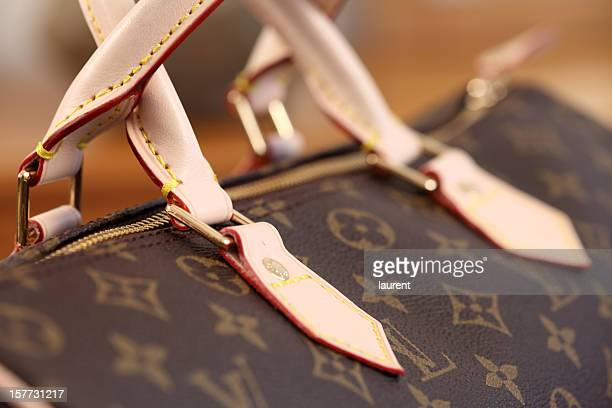louis vuitton bag - clutch bag stock pictures, royalty-free photos & images