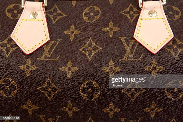 louis vuitton bag - louis vuitton designer label stock photos and pictures