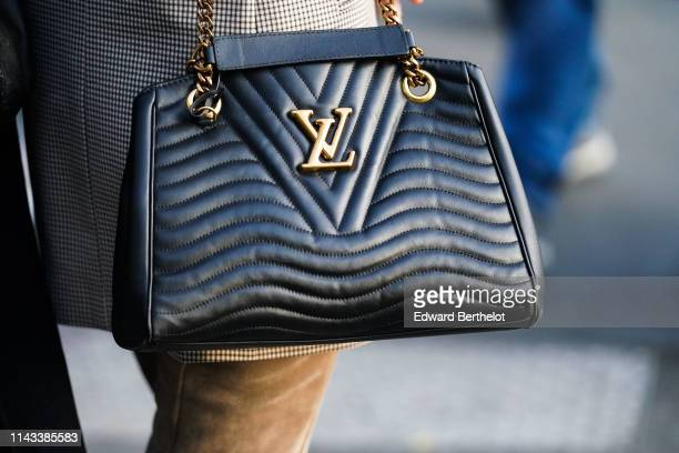 Louis Vuitton black leather padded bag is seen on April 18 2019 in Paris France
