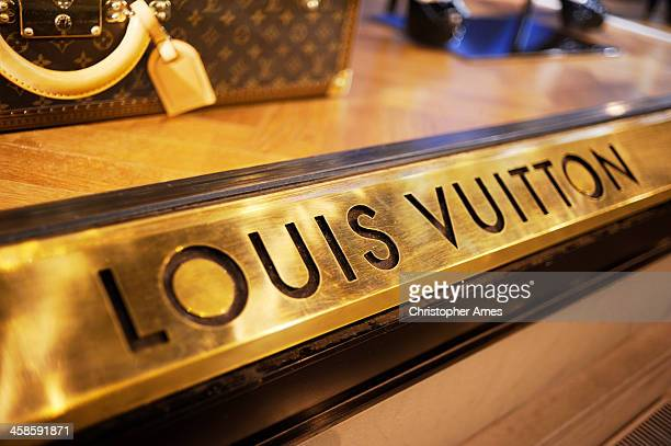 louis vuitton boutique window in florence - louis vuitton designer label stock photos and pictures
