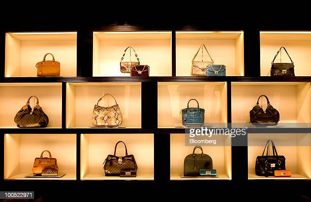 28680bb80437 Louis Vuitton branded goods sit on display at the LVMH Moet Hennessy Louis  Vuitton SA maison
