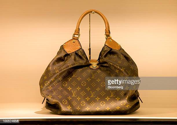 c30f34ffbf82 A Louis Vuitton branded handbag sits on display at the LVMH Moet Hennessy  Louis Vuitton SA