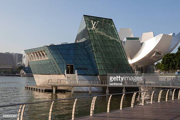 louis vuitton island maison in singapore - louis vuitton designer label stock photos and pictures