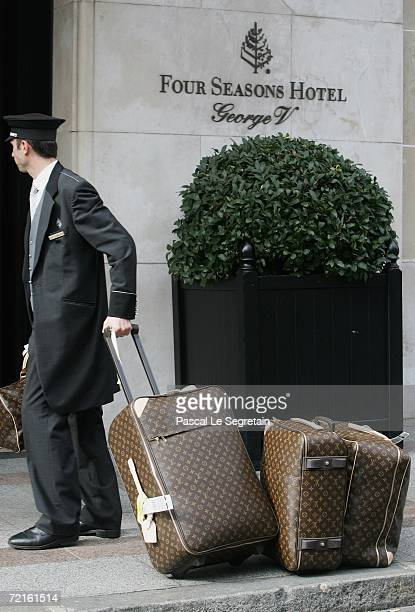 Louis Vuitton luggage is carried by the door man of the Georges V hotel on October 13 2006 in Paris France