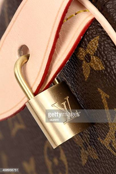 louis vuitton padlock - louis vuitton purse stock pictures, royalty-free photos & images