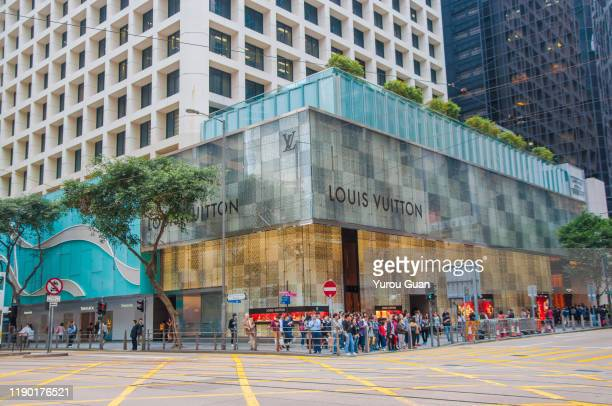 louis vuitton (lv) shop in central, hong kong. - hong kong stock pictures, royalty-free photos & images