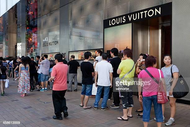 louis vuitton shop in hong kong - fashion hong kong stock photos and pictures