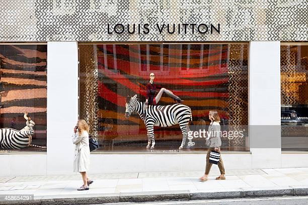 louis vuitton shop windows, london - louis vuitton designer label stock pictures, royalty-free photos & images