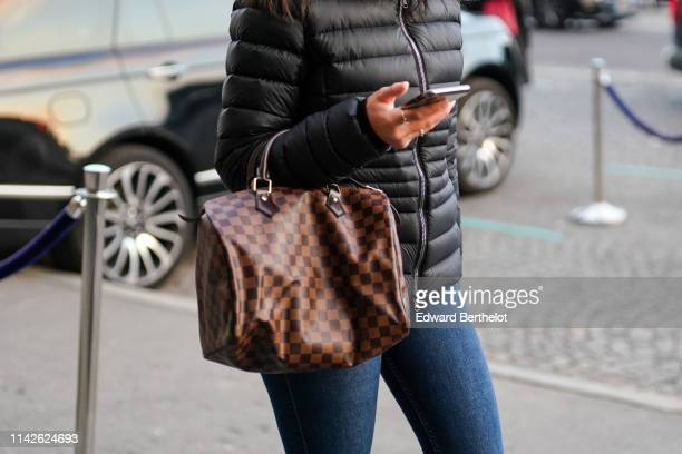 Louis Vuitton speedy brown bag is seen on April 12, 2019 in Paris, France.