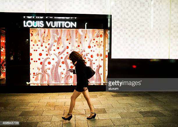 louis vuitton store in tokyo japan - japanese short skirts stock photos and pictures