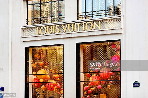 louis vuitton store - louis vuitton designer label stock photos and pictures