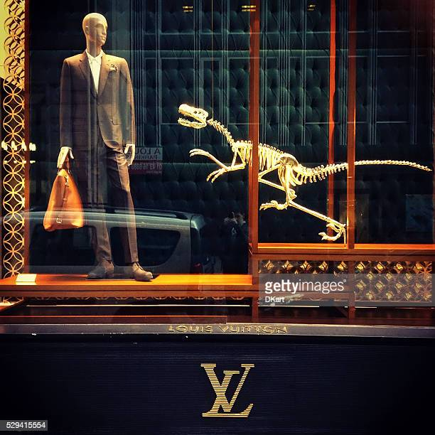 louis vuitton store showcase on the champs elysees - louis vuitton designer label stock photos and pictures