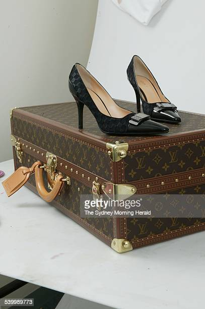 A Louis Vuitton suitcase and pair of high heels 11 January 2005 SMH Picture by MARCO DEL GRANDE