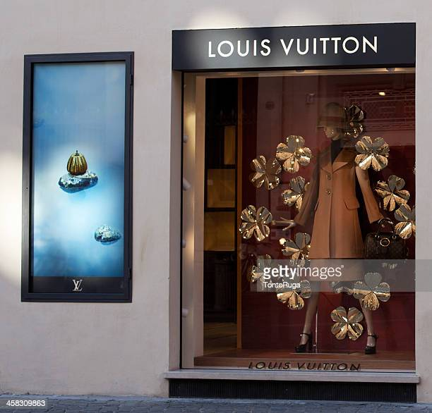 louis vuitton window store - louis vuitton designer label stock photos and pictures