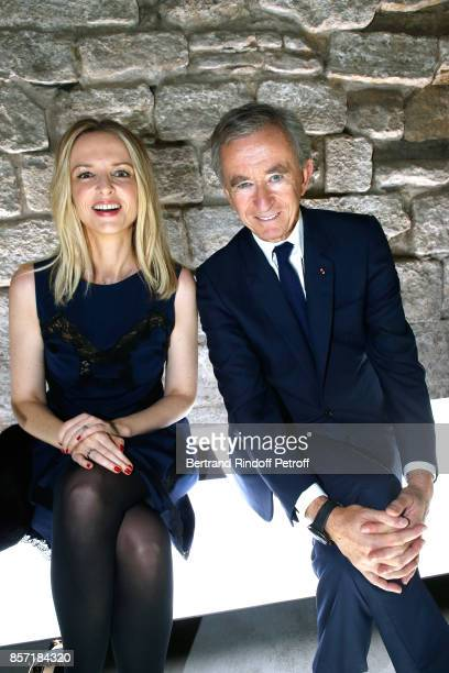 Louis Vuitton's executive vice president Delphine Arnault and her father Owner of LVMH Luxury Group Bernard Arnault attend the Louis Vuitton show as...