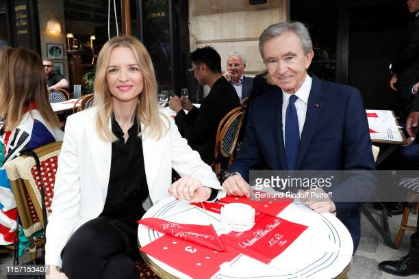 Louis Vuitton's executive vice president Delphine Arnault and Owner of LVMH Luxury Group Bernard Arnault attend the Louis Vuitton Menswear Spring...