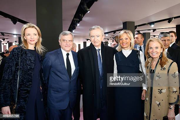 Louis Vuitton's executive vice president, Delphine Arnault, CEO Dior Sidney Toledano, Owner of LVMH Luxury Group Bernard Arnault, his wife Helene...