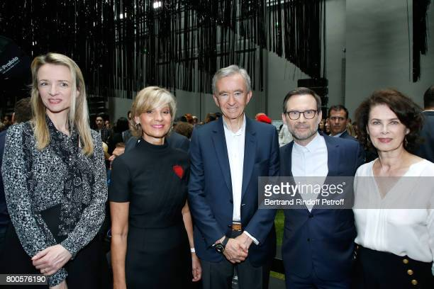 Louis Vuitton's executive vice president Delphine Arnault Helene MercierArnault her husband Owner of LVMH Luxury Group Bernard Arnault Christian...